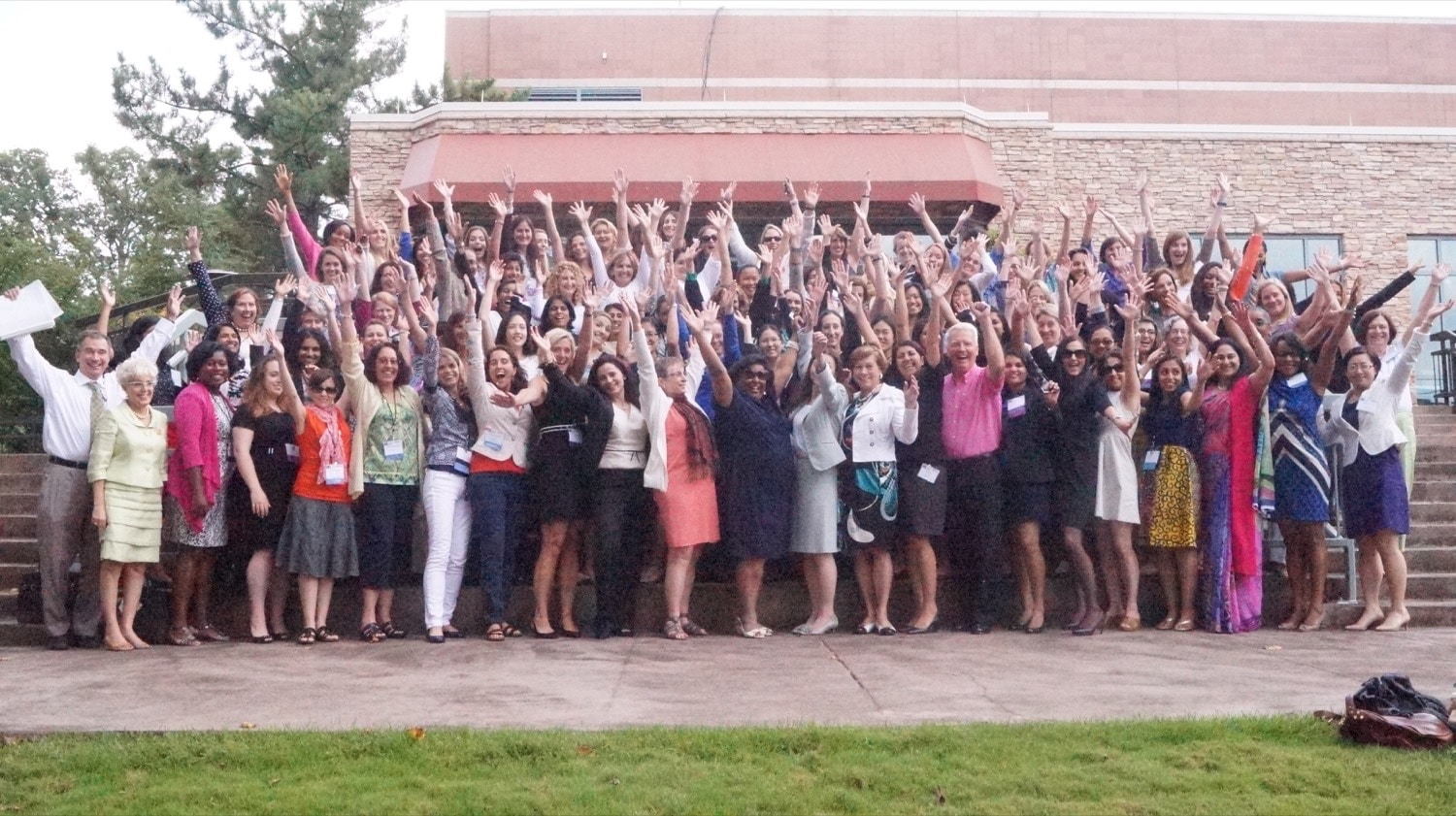 Summer Symposium 2014 Group Shot Hands Up