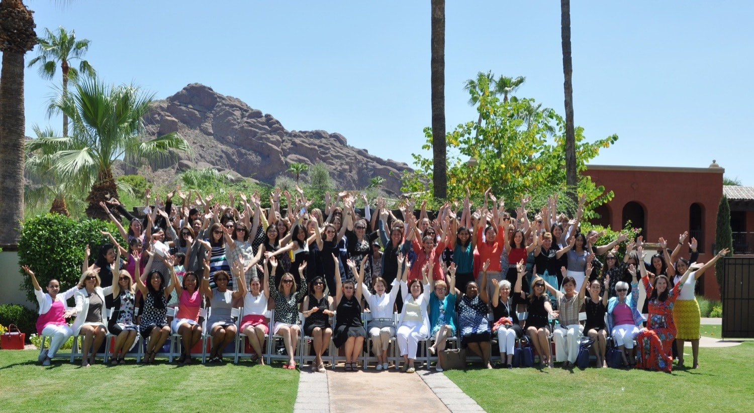 Summer Symposium 2015 Group Shot Hands Up2